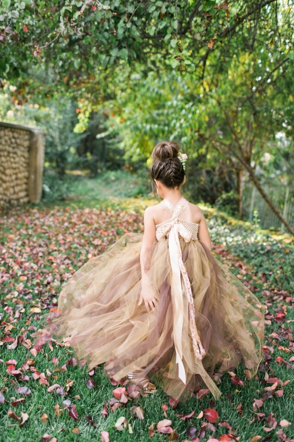7a98ec886060 Flower girl for a rustic fall forest inspired wedding courtesy of Sara  Lucero Photography.